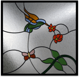 Stain glass art with butterfield hummingbirds